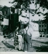 A family looking at ruins in London 1942
