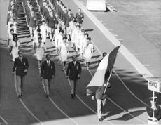 Marching people from France during Olympics parade.  - Oct 1964