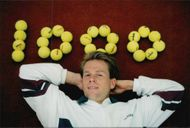 """Stefan Edberg poses at the text """"1000"""" written with tennis balls after his 1000th played tennis match in the Eurocard Cup 1995"""