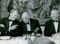 Willy Brandt talking to Charles de Gaulle with Georges Pompidou.