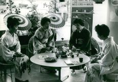 Women dressed in Japanese Kimonos, dining together at a restaurant in Tokyo, Japan.  - 1962