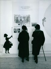 """Man and woman standing and looking at an artwork in an exhibition in Millesgården.  """"Millesgården exhibition"""""""