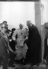 Pope Paul VI walking.