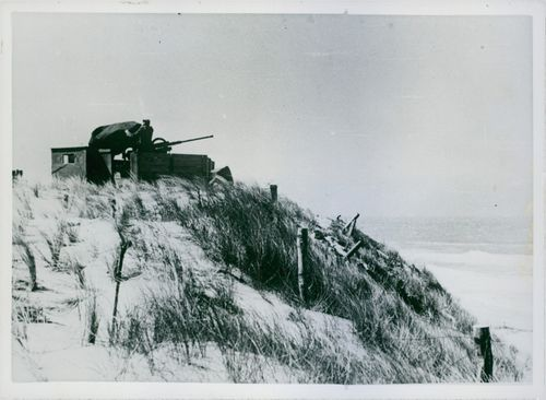 Soldier with cannon at the hill top.