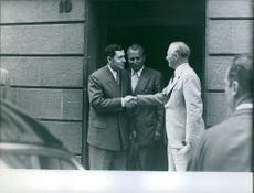 Andrei Gromyko shaking hand with a man.
