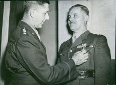 General Maurice Mathenet being awarded by Lieutenant General Jacob L. Devers.