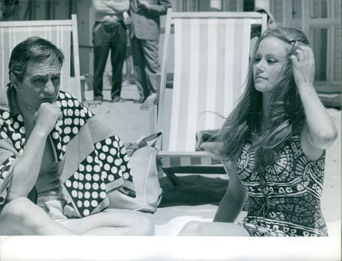 Claudine Auger sitting with man.