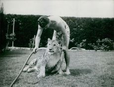 A man pouring water on lion.