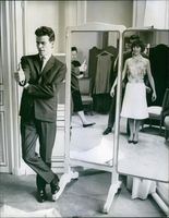Horst Werner Buchholz standing beside the mirror and posing with wife, 1961.