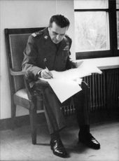 Czeslaw Kiszczak sitting and writing.
