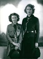 Queen Elizabeth II and Princess Margaret photographed in the uniforms of Girl Guides in 1942, when they were 16 and 13 respectively.