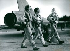 Three female students in flight crash in front of a fighter aircraft at Tullinge airfield.