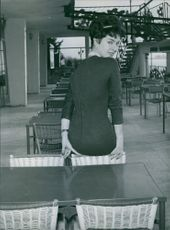Silvana Pampanini posing in a dining table.