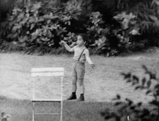 Jacques Charrier's son playing on ground.