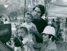 """Anthony Newley is photographed with his wife Joan Collins and their two children on the set of """"Doctor Dolittle""""."""