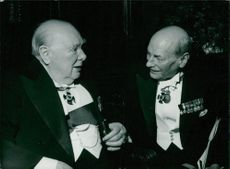 Winston Churchill talking with Earl Attlee at London's Drapers' Hall on the occasion of the presentation to Sir Winston of the first Williamsburg Award.