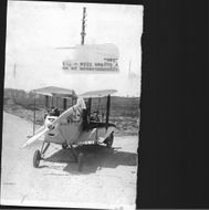 Early flying machine during transport to Värtan with Captain Riis in the background - Year 1923
