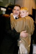 Actress Sharon Stone hugs her husband Phil Bronstein before leaving the hotel after gala in favor of AIDS research