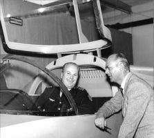 Major Gosta Norrbohm, Air Force, and dir, Lars Brising, Saab, at a full scale model of the new trainer- and passenger aircraft.