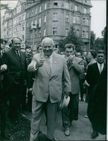 Nikita Sergeyevich Khrushchev smiling while greeting the people on a welcoming mode on the street in Austria.