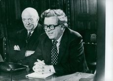 Lord Thorneycroft and Sir Geoffrey Howe sitting together during a meeting of the Shadow Cabinet in Whitehall.  - 1978
