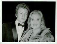 "Actress Hayley Mills with his brother John at the premiere of the movie ""Quiller - Our Ace in Berlin"" at the Odeon Theater"
