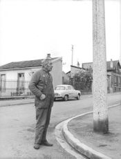 A man standing on road.