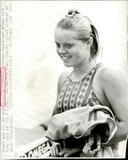 Gunilla Andersson leaves the pool after a nice run of 100 meters butterfly and is ready for the final.