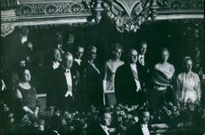 Charles de Gaulle standing with the royals.