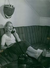 A young lady speaking on the phone.