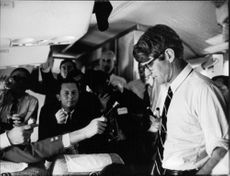 "Press reporters asking Robert Francis ""Bobby"" Kennedy."