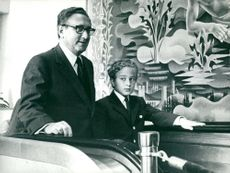 Henry Kissinger with the son of David