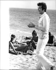 Herb Alpert on the beach with some women, 1969.
