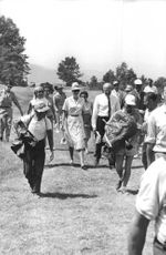 Grace Kelly walking with other people.