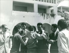 People hugging Ahmed Ben Bella.  Taken - June 1965