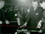 Prince Bertil, assisted by LO chairman Arne Geijer, to slay a hammer at the inauguration of Scania-Vabis new industrial school