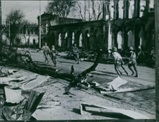 Original photo of the East Asian War Memorial.  Mandalay in Japanese hand - Japanese soldiers roam the streets of Mandalay which show visible traces of air raids.