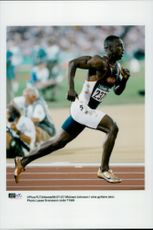 Michael Johnson in his golden shoes
