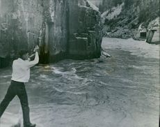 A man throwing back a Red Sokeye into the Hell's Gate river.