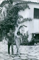 Prince Xavier of Bourbon-Parma walking with woman. 1964