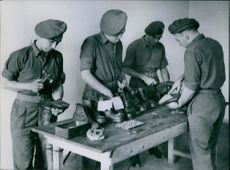 Occupation troops go to school With the present difficulties of shoe repairs, this is a useful job to learn.