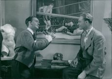 """Ake Soderblom and Allan Bohlin in a scene from the 1943 Swedish drama film, """"The Priest Struck the Knockout""""."""