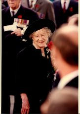 Queen Elizabeth is mingling during an event.