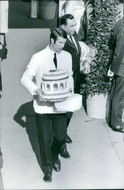 A man holding a cake.