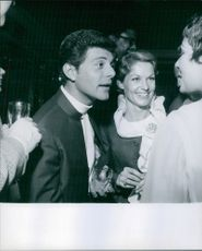 Frankie Avalon with wife Kathryn Diebel talking to someone.  1968
