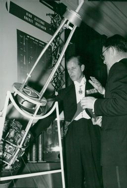 Prince Philip inspects a rocket head at the Royal Societys conference in connection with the opening of the International Geophysical Year