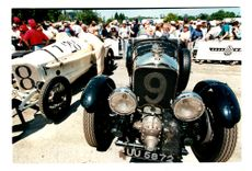 Visitors inspect racing car during Goodwood festival of speed at Goodwood House
