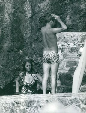 Princess Margriet of the Netherlands and Pieter van Vollenhoven in swimsuits.
