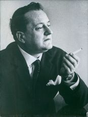1966 Bulgarian writers Andrei Gulyashki smoking.