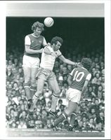 Willie Young (Arsenal) and Peter Withe